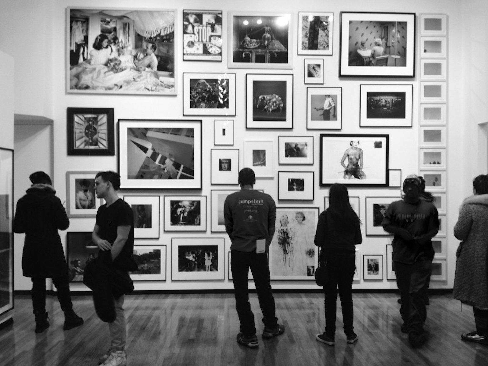 PHOTO: GRACE HAUCK Visitors peruse the main floor of the Museum of Contemporary Photography's latest exhibition, MoCP at 40, which debuted on January 25 and will run through April 10.